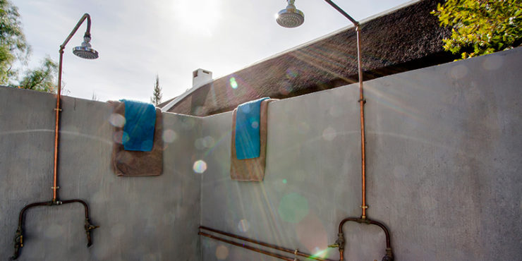 15. Honeymoon outside shower McGregor Yellowstone Cottages 183